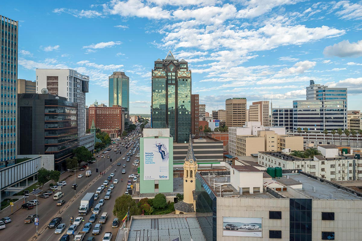 Harare city with cars driving past the Century Towers