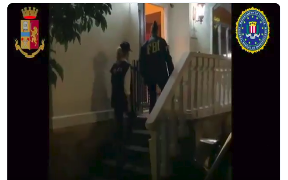 "FBI agents enter a home in connection to the ""New Connection"" case (Source: Polizia di Stato Twitter"