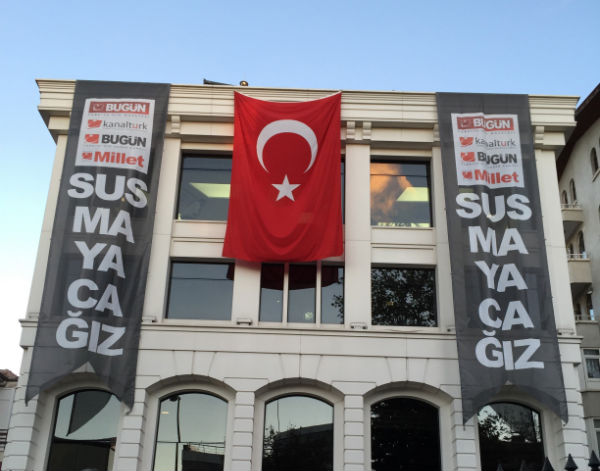 Protest flags against raids on Koza Ipek media group.