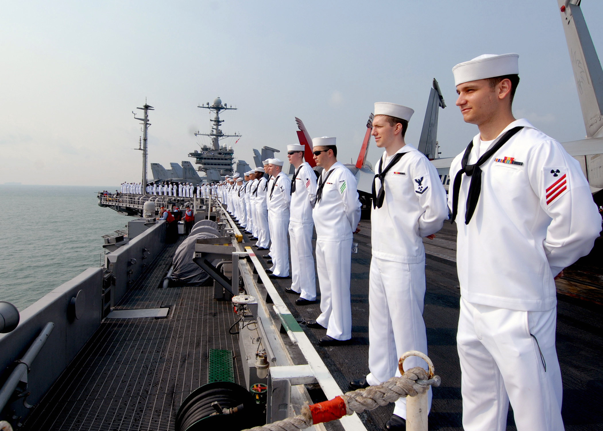 US Navy 090802-N-6720T-045 Sailors man the rails aboard the aircraft carrier USS George Washington CVN 73 while underway off the coast of Singapore