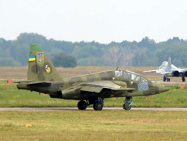 Ukrainian Air Force Su-25UB with two MiG-29s 9-13 in background copy