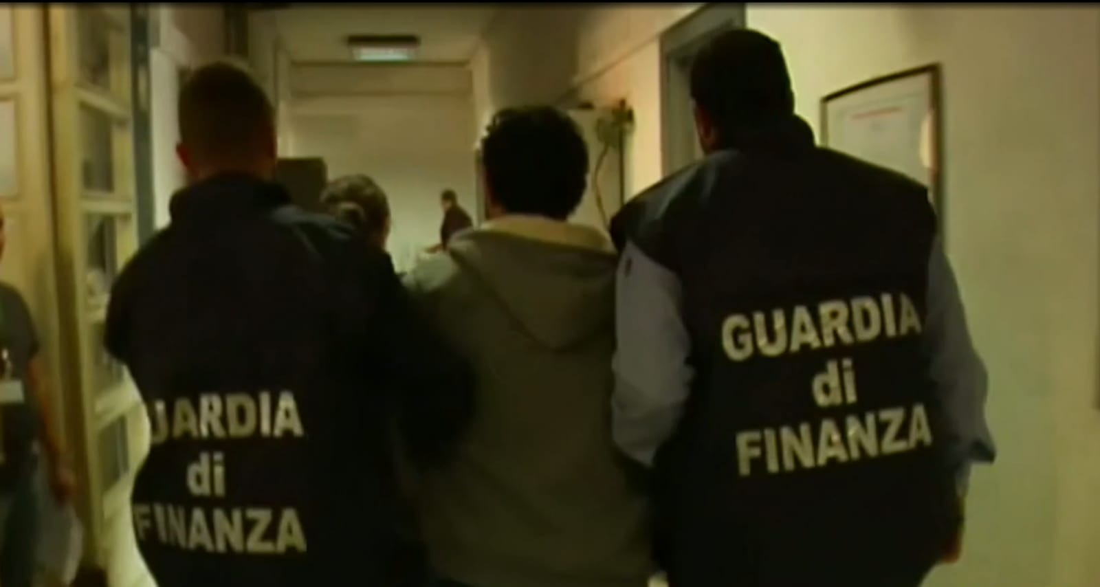 One of the suspects is arrested. (Photo: Guardia di Finanza)