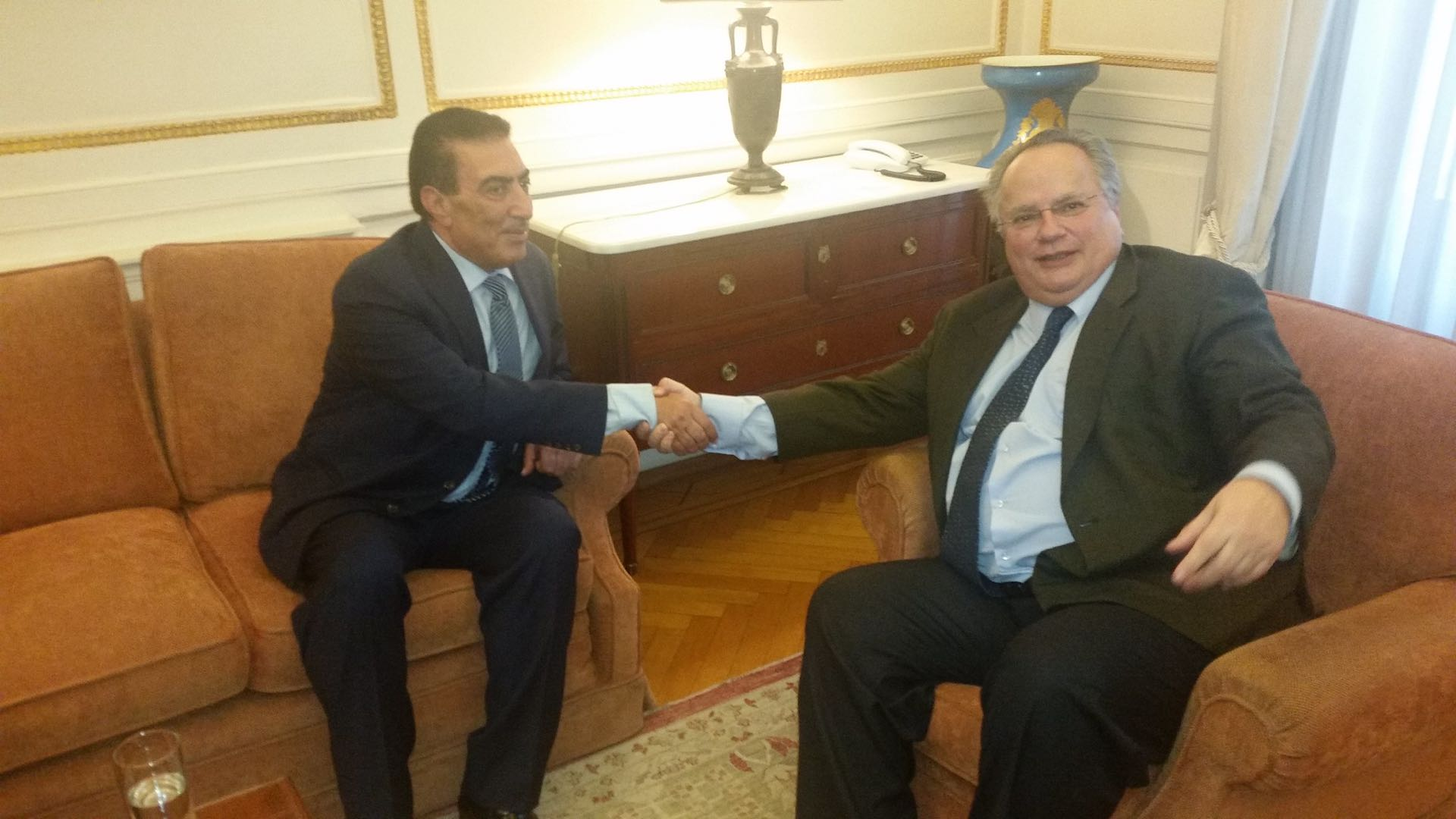 Atef Tarawneh, left, shakes hands with Greece's then-Minister of Foreign Affairs Nikus Kotzias on March 3, 2016. Credit: Hellenic Ministry of Foreign Affairs