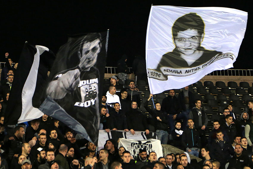 FK Partizan supporters wave flags during a match (Photo: Aubrey Belford)