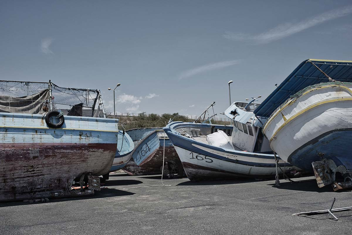 Confiscated wooden boats used by smugglers at the harbor in Pozzallo, Sicily (Photo: Valentino Bellini)