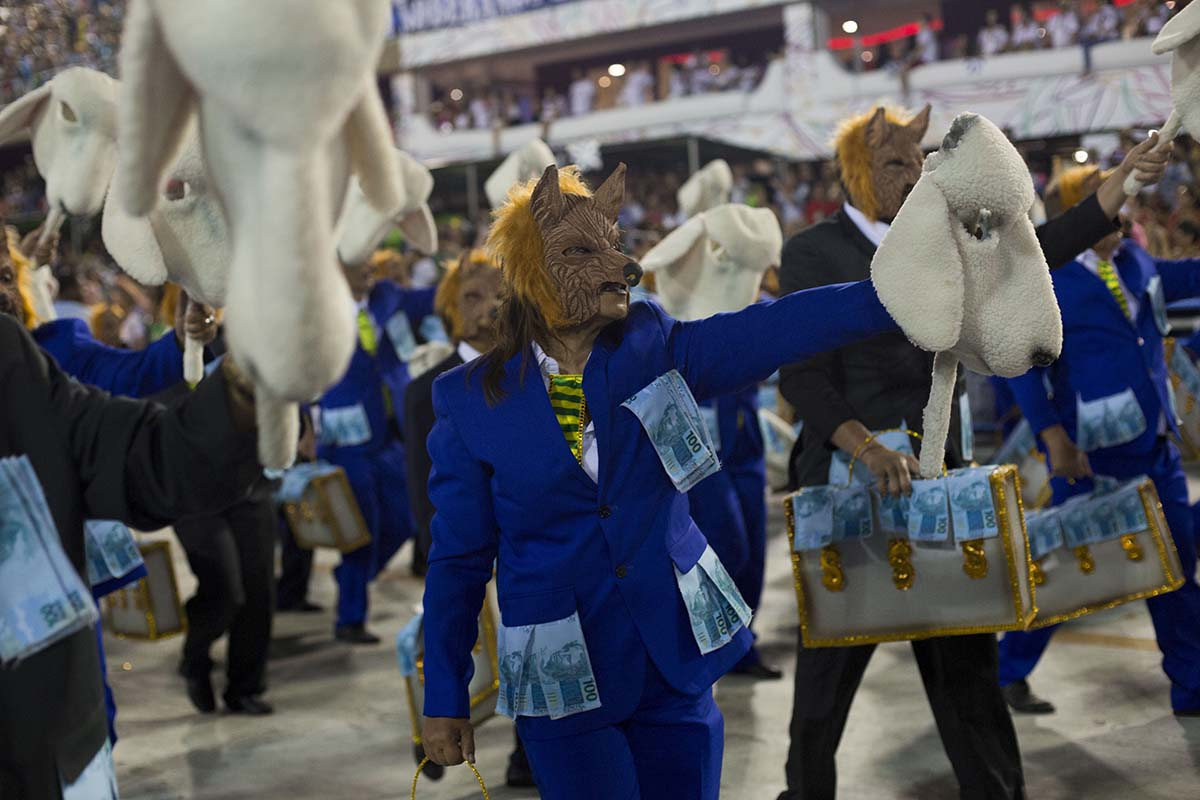 Dancers dressed as wolves in sheep clothing. (Photo AFP)