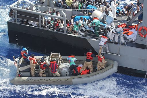 Distressed persons are transferred to a Maltese patrol vessel. 2