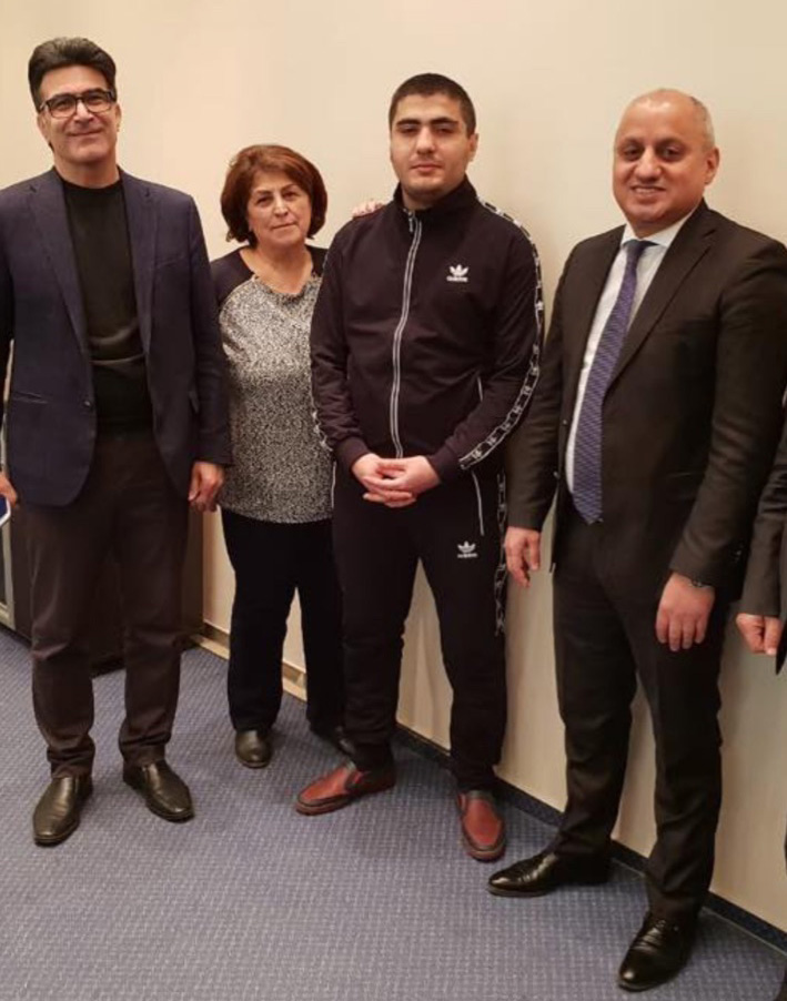 Mehman Huseynov (second from right) pictured with visitors Tuesday. (Photo: Radio Free Europe/Radio Liberty)