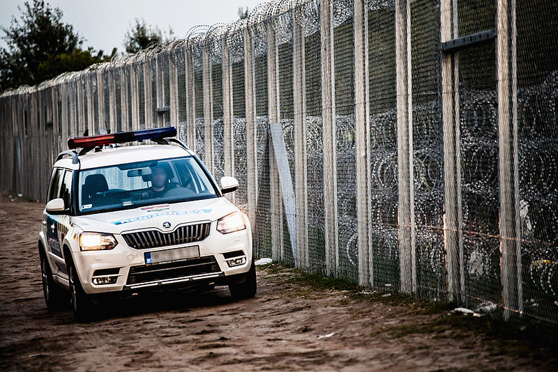 Police car at Hungary-Serbia border barrier