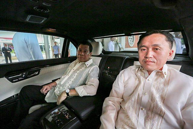 Rodrigo Duterte is inside an official state car with Special Assistant to the President Christopher Lawrence copy
