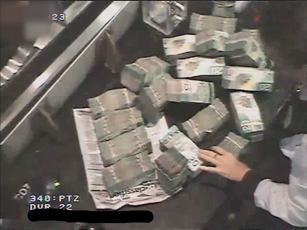 'Dirty money' is seen being exchanged at a Canadian casino. (Courtesy: Provincial Government of British Columbia)