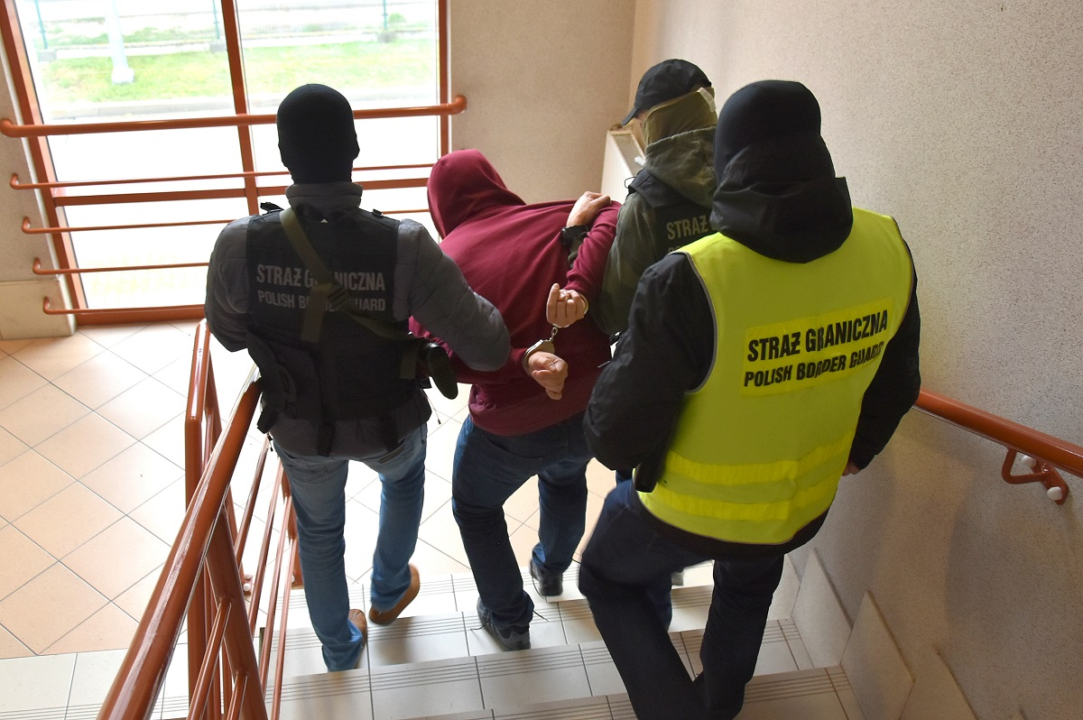 Polish police are seen taking away a suspected human trafficker. (Europol)