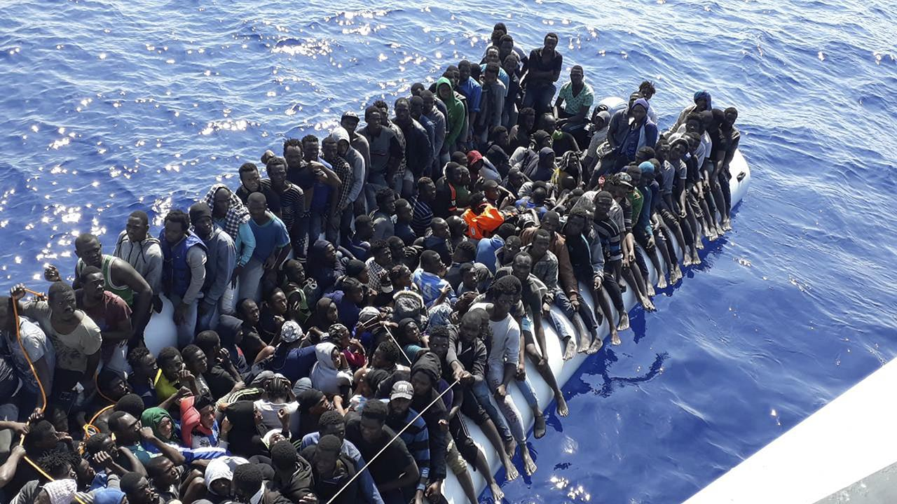 Photo released by the Libyan Coast Guard on June 24, 2018 shows migrants on a ship intercepted offshore near the town of Gohneima, east of the capital, Tripoli. There were four boats, boarding 490 African migrants including 75 women and 21 children, Spokesman Ayoub Gassim said. (Libyan Coast Guard via AP)