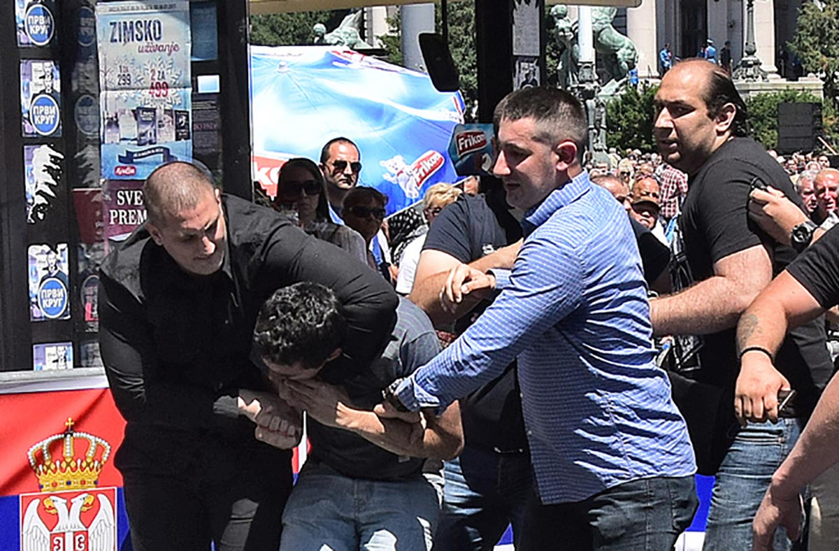 A man identified as Borko Aranitovic assaults a protester during the new Serbian president's inauguration ceremony on June 23. (Photo: E-stock.us/Aleksandar Bačlija)
