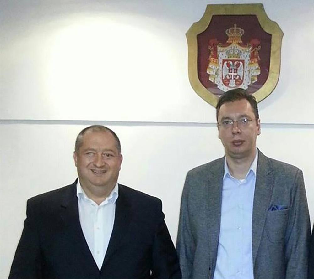 Serbian President Vucic with Petar Panic in front of the Serbian Coat of Arms. According to Panic's caption, the photo was taken in 2013, when Vucic was First Vice President and Minister of Defence. (Photo: Facebook)