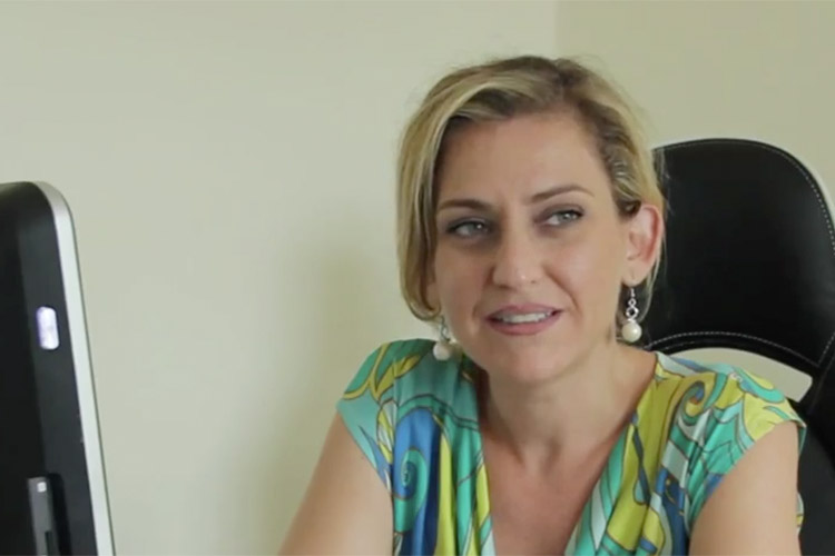 Screenshot of Jole Figliomeni in a promotional video for the IT company she worked for in the Ivory Coast.