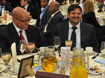 Former South African president Jacob Zuma dines with Atul Gupta (right) during an SABC business briefing, Port Elizabeth, South Africa, March 2012. Credit: GovernmentZA / Flickr
