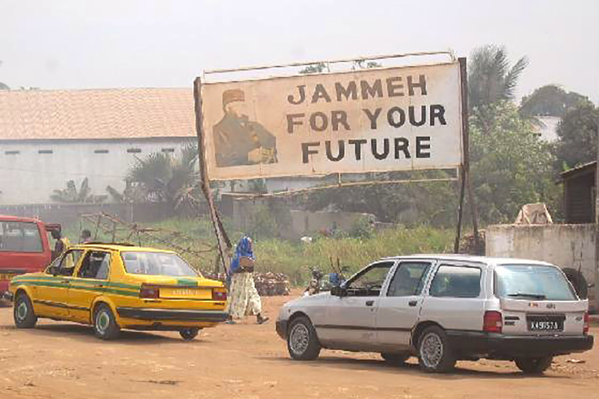 Jammeh_Billboard.jpg. Caption: A billboard praising former President Yahya Jammeh in Serekunda, 2005. Credit: Atamari / Wikimedia Commons