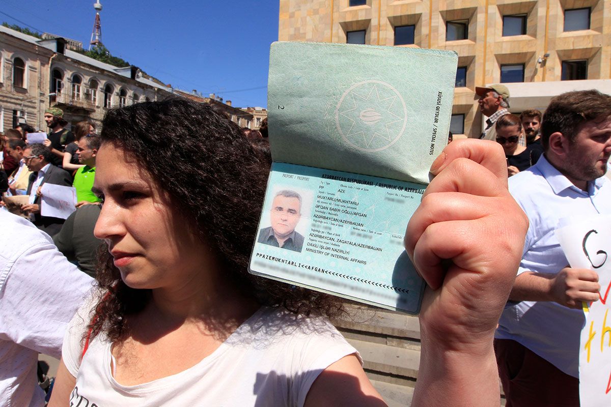 Leyla Mustafayeva, wife of newly imprisoned Azerbaijani journalist Afgan Mukhtarli, attends a rally in his support in Tbilisi, Georgia on May 31. (Photo: AP Photo/Shakh Aivazov)