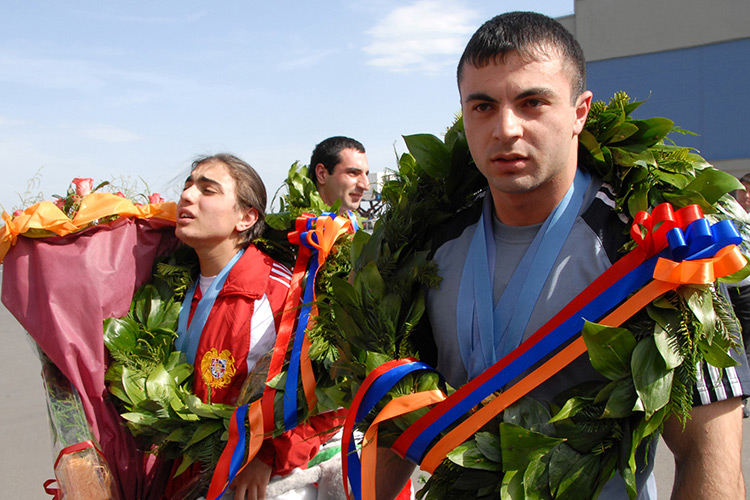Tigran V. Martirosyan (right) returns home after competing in the World Weightlifting Championship in France in 2011. (Photo: PHOTOLURE / Vahram Baghdasaryan)