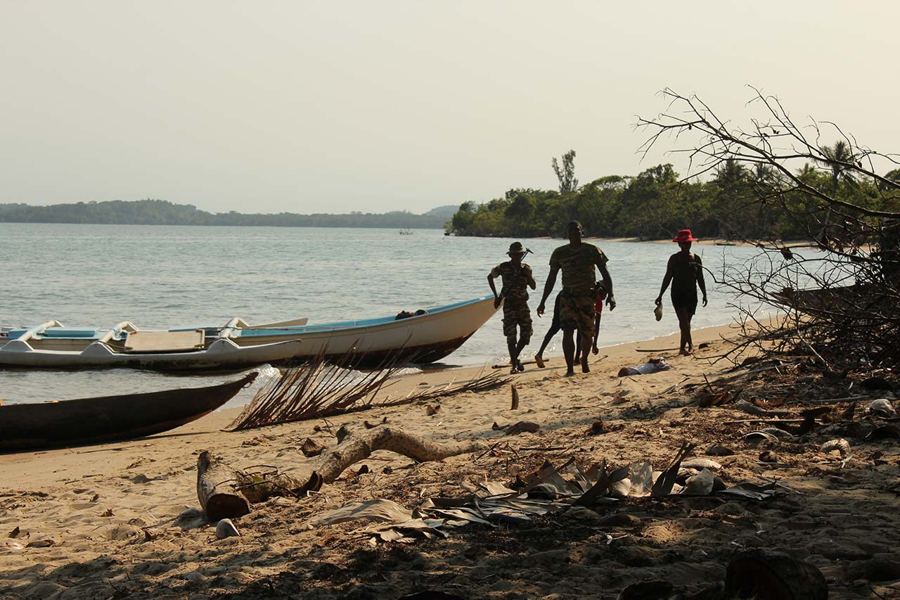 Canoes on a beach in the Sava Region, of the type used to transport rosewood from nearby national parks. Credit: Khadija Sharife / OCCRP