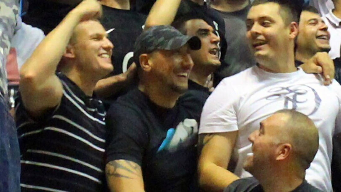 "Aleksandar Stankovic (""Sale the Mute"") and Nenad Vuckovic (""Vucko"") cheering together at a football game. (Photo: Author unknown)"