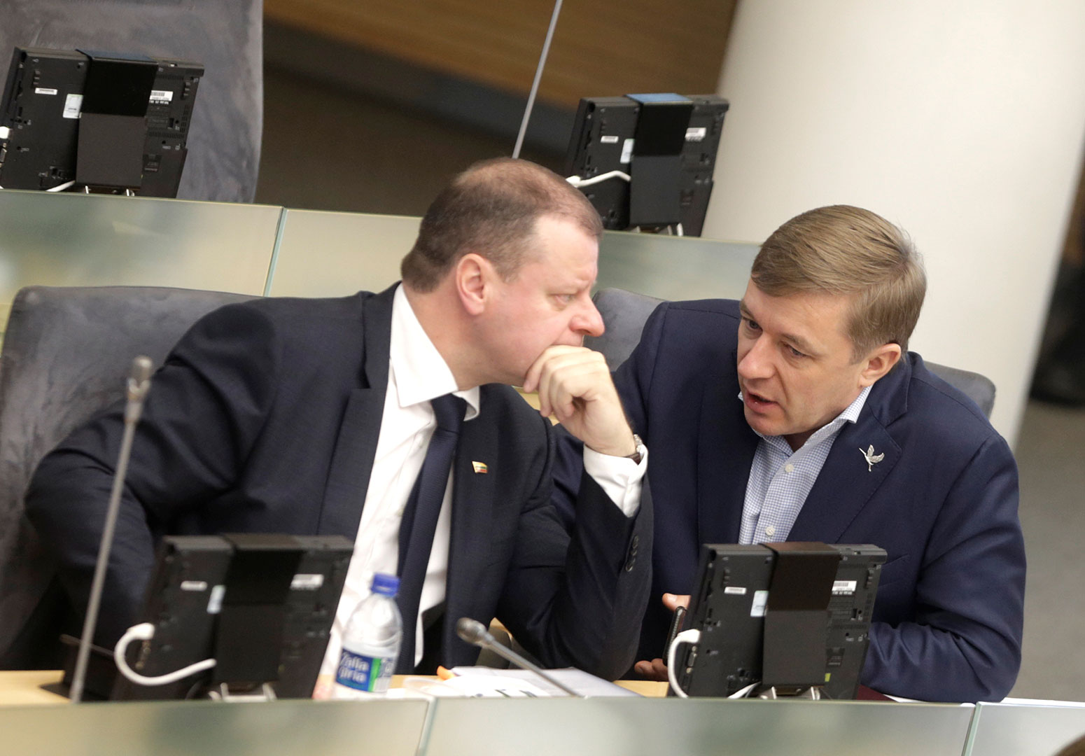 Saulius Skvernelis listens to Ramunas Karbauskis before his swearing in as prime minister in the Seimas, the Lithuanian parliament, December 2016. Credit: Ints Kalnins / Reuters