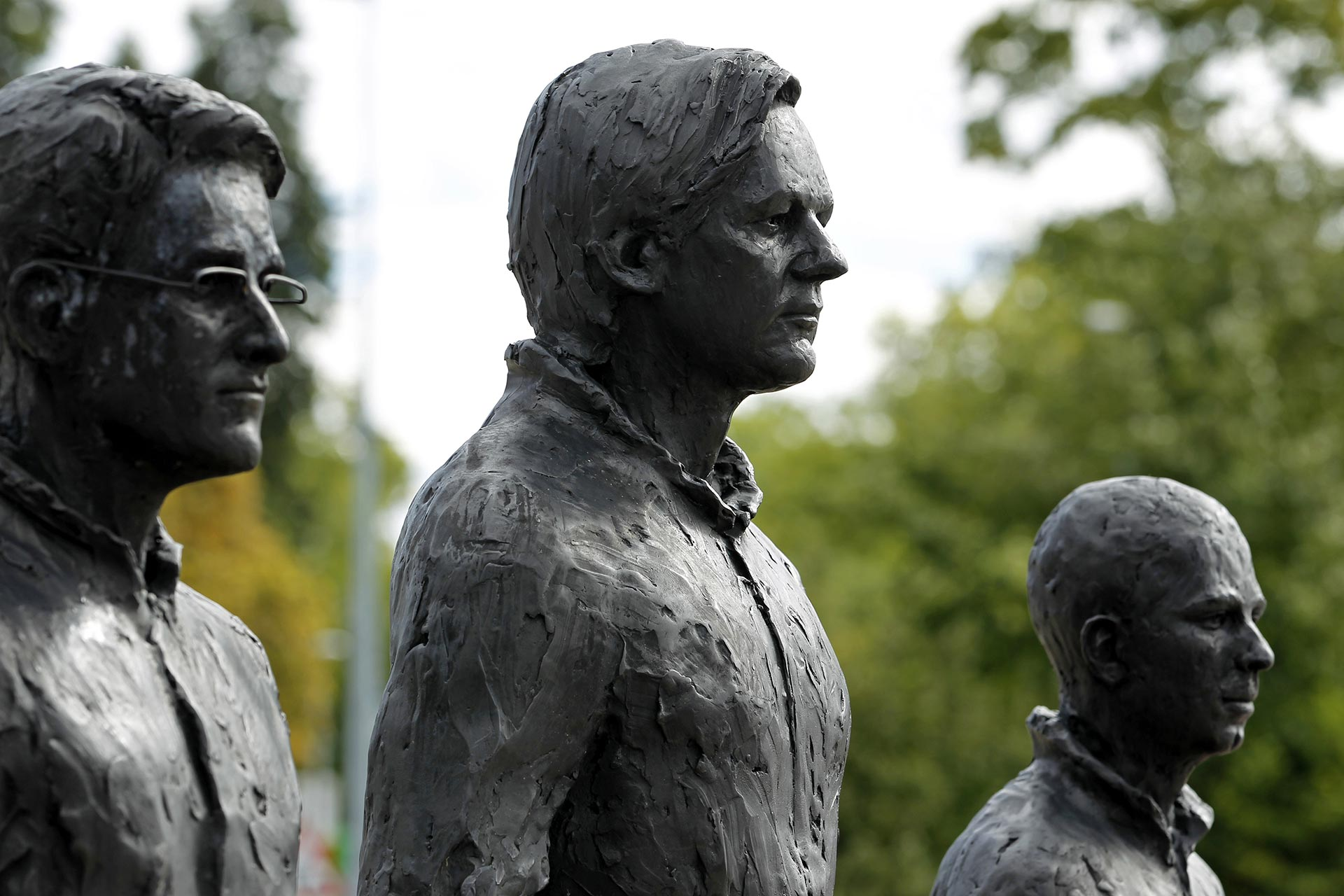 "Whistleblowers Edward Snowden, Julian Assange and Chelsea Manning depicted in an art installation entitled ""Anything to Say?"" in an art installation outside the U.N. European headquarters in Geneva, Switzerland, in 2015. (Credit: Pierre Albouy/Reuters)"