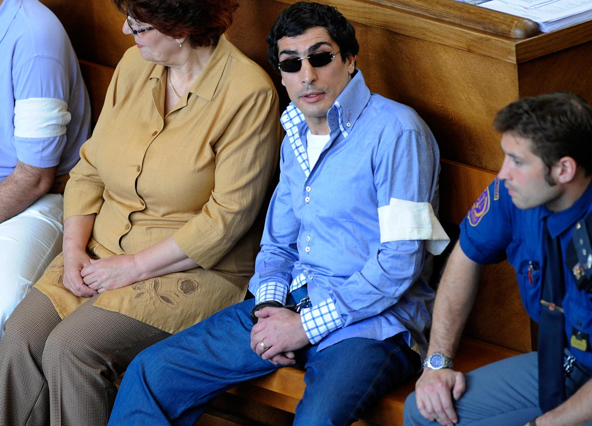 Police say Andranik Soghoyan, in blue shirt, is a 'vor v zakone,' or thief-in-law, who headed an organized crime group in Prague. (Czech Press Agency photo)