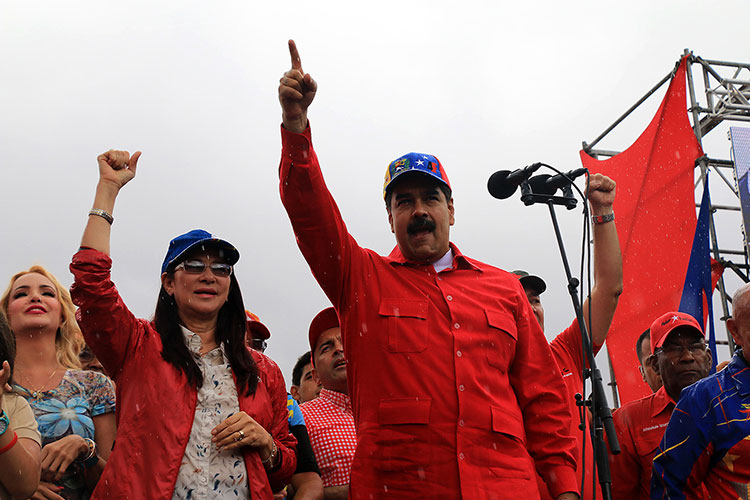 Cilia Flores (left) and Nicolás Maduro (right) during a public meeting in Caracas.