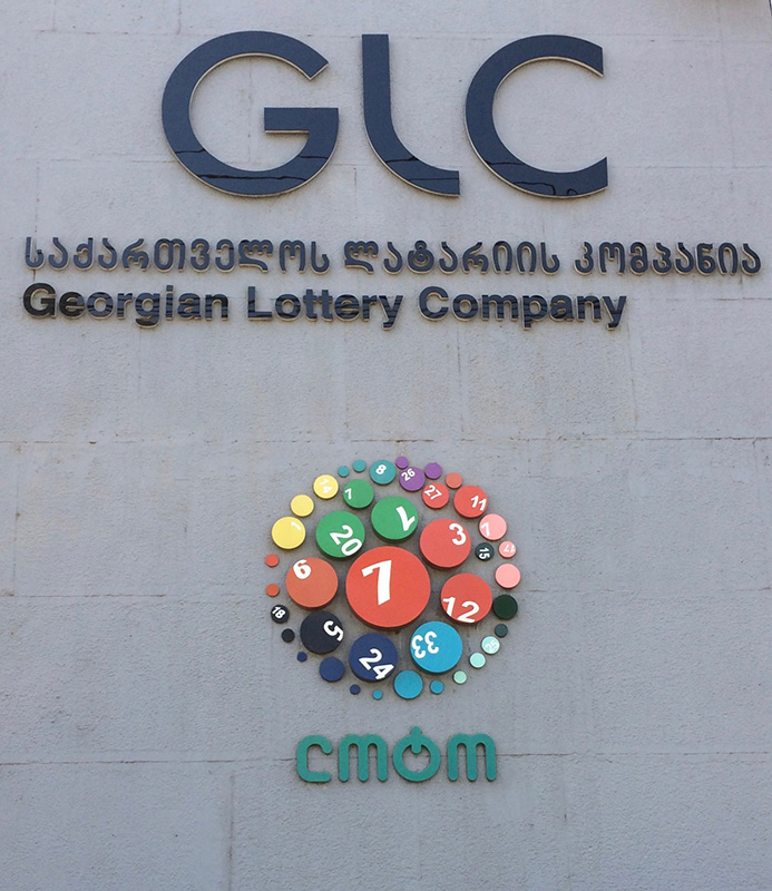 "The logo for the Georgian Lottery Company and for the ""Loto,"" its popular nickname, on the company headquarters building in Tbilisi. (Photo credit: OCCRP)"