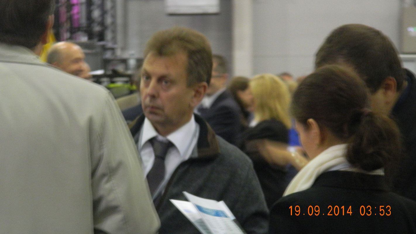 Igor Borisov flanked by his colleagues in the hangar in Edinburgh where the final count took place.