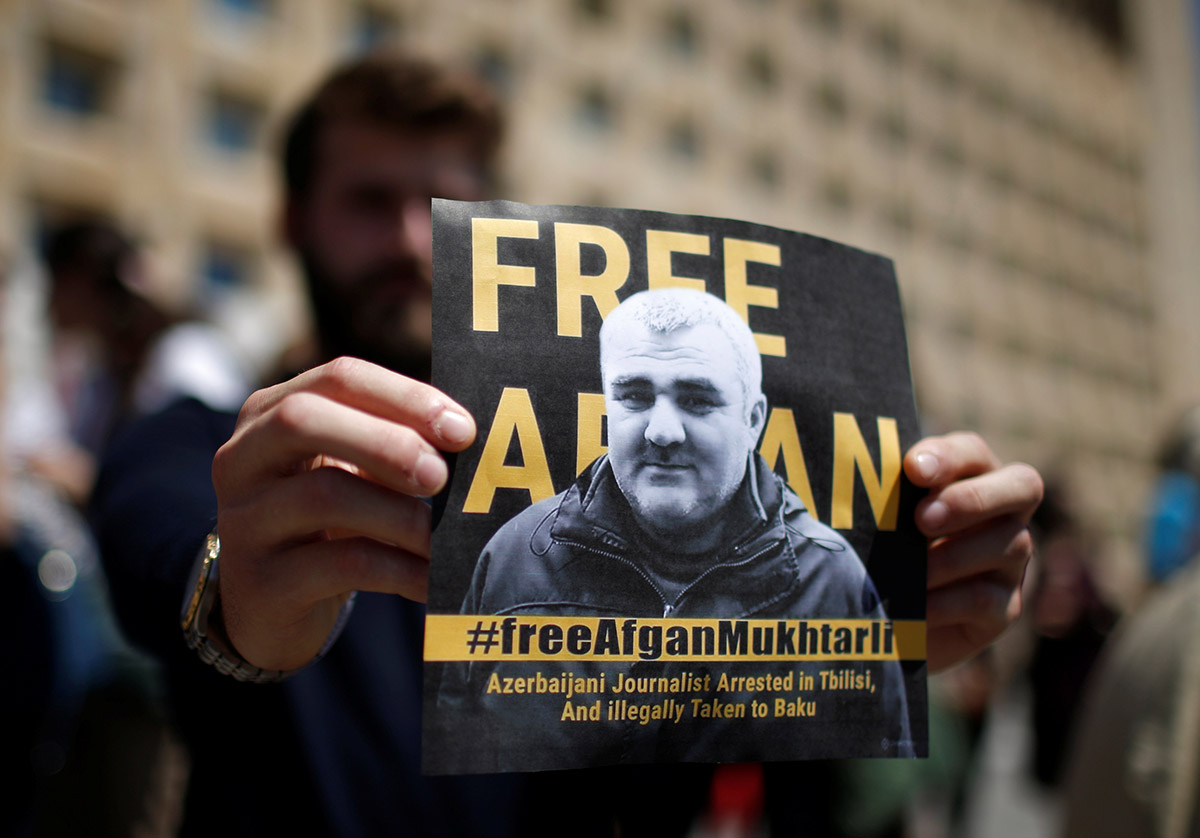 ournalists rally to support newly imprisoned Azerbaijani journalist Afgan Mukhtarli in Tbilisi on May 31. (Photo: Mzia Saganelidze for RFE/RL)