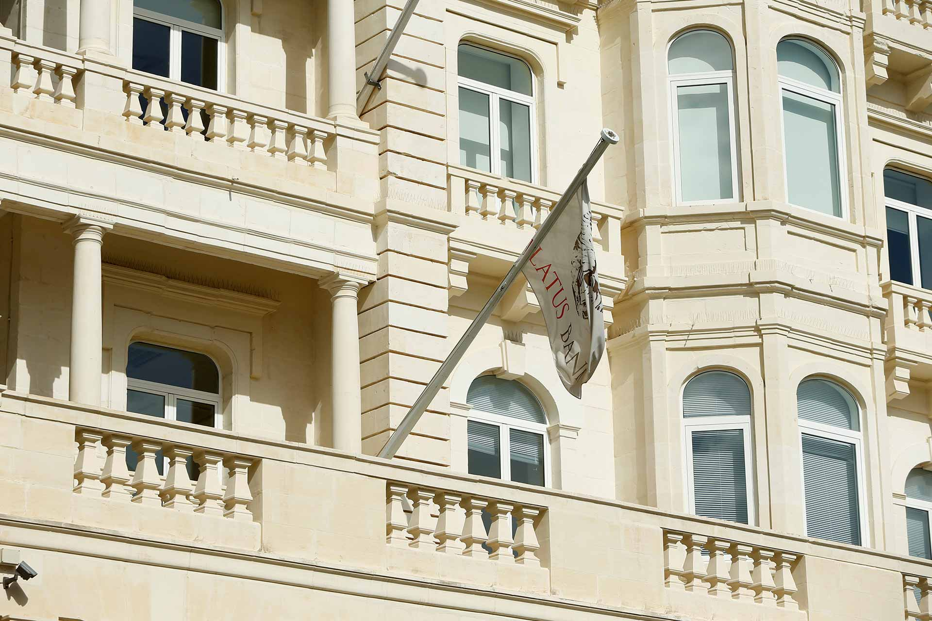 The flag of Pilatus Bank flies from its offices in Whitehall Mansions in Ta' Xbiex, Malta. Photo (c): REUTERS/Darrin Zammit Lupi