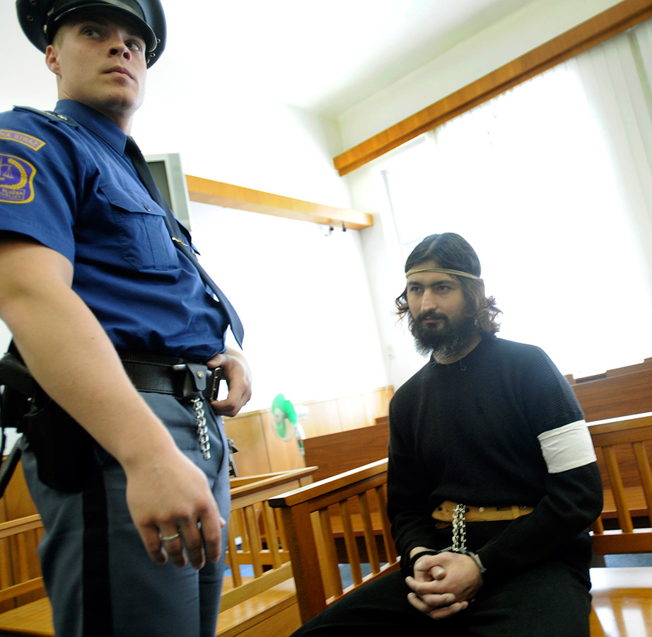 "Accused Ukrainian assassin Timur Tretyakov, who twice attacked the wrong victims, appeared in a Prague court dressed in religious garb and calling himself ""God's slave."" (Czech Press Agency photo)"