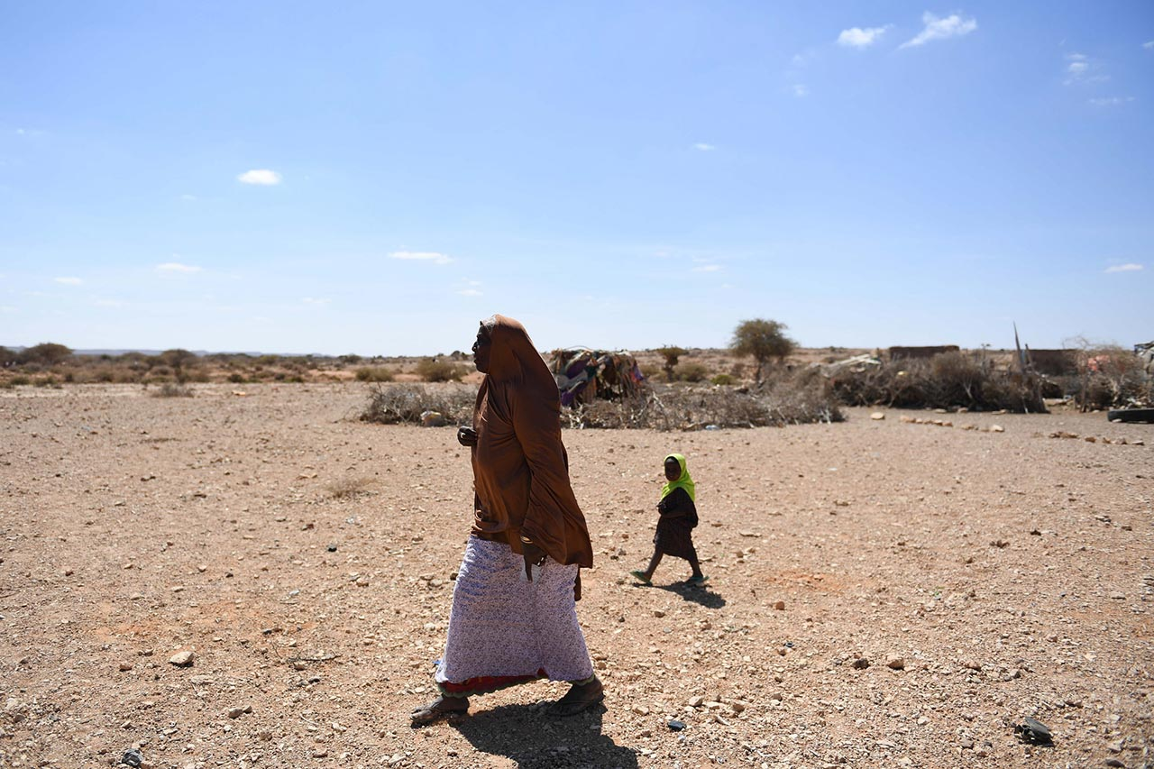 A woman walks in drought-hit Salaxley village, 15 kilometers south of Garowe in Puntland, on February 01 2017. Puntland is one of the regions hit by a severe drought. UN Photo / Ilyas Ahmed
