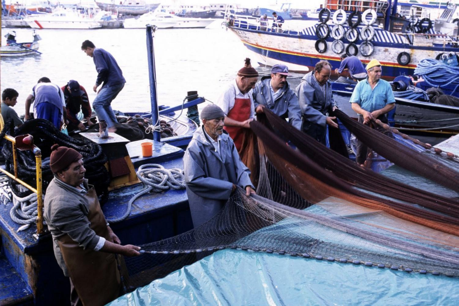 Fishermen at the harbour of Kelibia. (Credit: Hemis / Alamy Stock Photo)