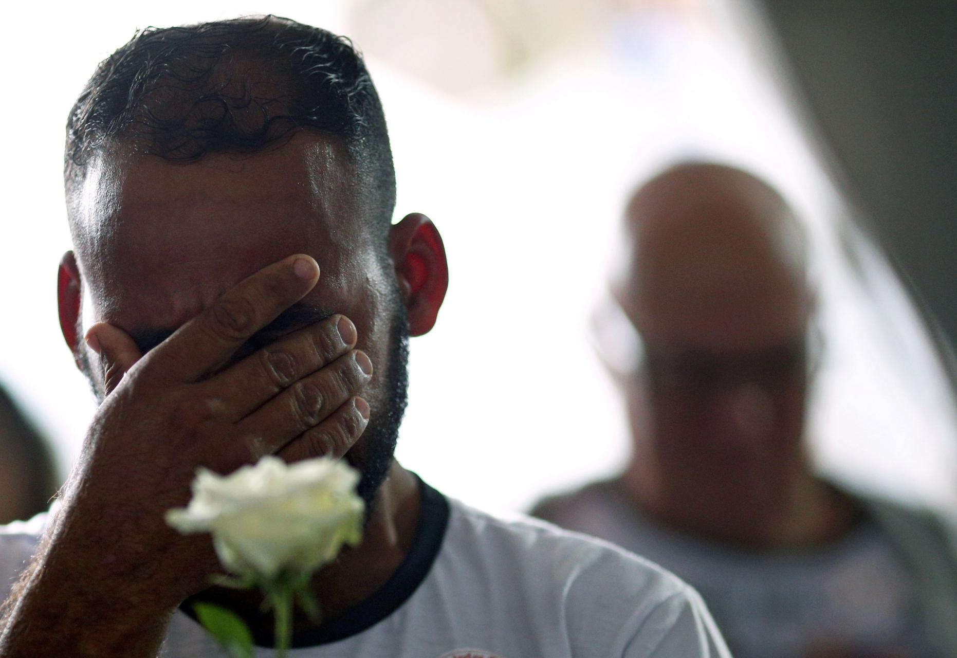 A relative of a victim reacts during a ceremony to mark one year since the Brumadinho disaster on January 25, 2020.  (Photo: Reuters/Cristiane Mattos)