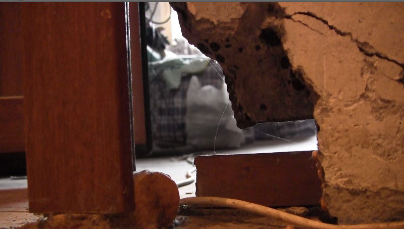 A broken wall in the home of Shamil Aliyev, now serving a prison term for a million-dollar tax liability.